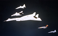 The ill-fated June 8, 1966 formation flight centered on the XB-70, flanked by a T-38A, F-4B, Walker's F-104N (orange tail), and an YF-5A.
