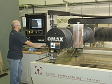 Dryden craftsman using the water jet precision machining equipment.
