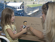 Dana's daughter and granddaughter, Leslie and six-year-old Jenna Kirby, take a look at their new family keepsake a bobblehead doll bearing Bill Dana's likeness