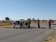 Crews prepare a Pipistrel Virus from Slovenia, Flight Designs CTsw, and an Urban Air Lambada from the Czech Republic for the CAFE 400 race.