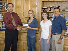 David McBride presents the 2008 Dryden Employee Exchange Council scholarship check to Jill Pestana, as her parents look on.