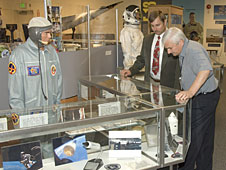 Center Director Kevin Petersen, right, gets a tour of the Gift Shop's new Space Race exhibit from Dryden historian/archivist Peter Merlin.