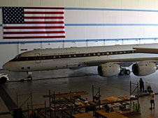 DC-8 in hangar with American flag in the background