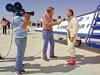 A TV reporter interviews NASA test pilot Bill Dana, wearing his infamous pink boots with yellow daisy decals, after the last powered flight of the X-24B.
