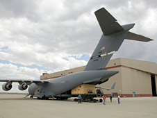 Mirror for NASA's Stratospheric Observatory for Infrared Astronomy is unloaded from Air Force C-17 transport plane.