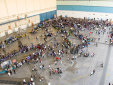 Hundreds of high school students thronged career-oriented exhibits and displays set up in a large aircraft hangar at the annual Salute to Youth career fair.