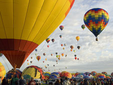 Albuquerque International Balloon Fiesta participants took advantage of good weather for the opening day of the event.