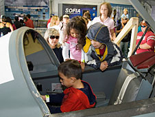 Sitting in a T-38 simulator gave visitors to the NASA exhibit a feel for an aircraft cockpit.