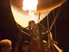 Propane flames heat the air inside a hot air balloon to prepare it for flight.