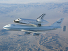 The Space Shuttle Endeavour mounted atop its modified Boeing 747 carrier aircraft flies over California's Mojave Desert on the first leg of its ferry flight back to the Kennedy Space Center on Dec. 10, 2008.