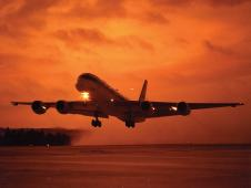 The DC-8 Airborne Science aircraft departs for a mission at dawn.