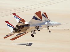 NF-15B Intelligent Flight Control System aircraft banking over Rogers Dry Lake Bed at Edwards.