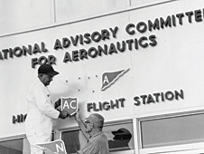 Employees change the sign when the National Advisory Committee for Aeronautics became the National Aeronautics and Space Administration on Oct. 1, 1958.