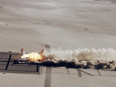 Boeing 720 Controlled Impact Demonstration aircraft burning.