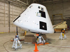 PA-1 boilerplate crew module undergoing center of gravity testing.