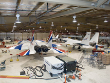 aircraft undergoing maintenance in hangar