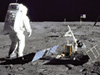 astronaut and lunar lander on moon