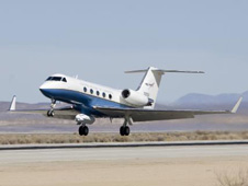 NASA's Gulfstream-III research testbed lifts off from Edwards AFB on a checkout test flight with the UAV synthetic aperture radar pod under its belly.