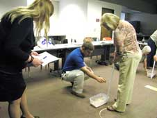 NASA Dryden historical archivist Peter Merlin assists two teachers at lunar workshop.