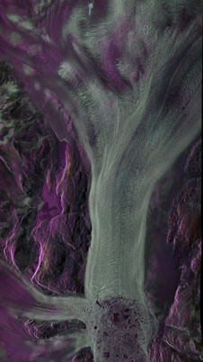 L-band polarmetric image of the Kangerlugssuaq ice fjord, centered at 68 degrees 38 minutes North, 33 degrees 03 minutes West. This false color 17 x 30 km SAR image is a composite of three polarizations with HH polarization colored red, HV colored green, and VV colored blue.