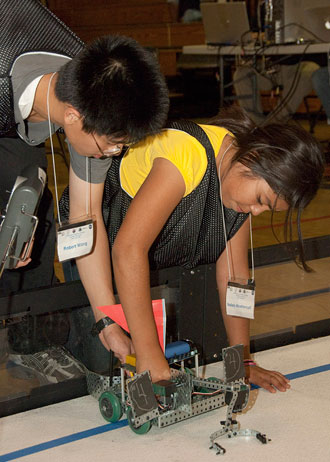 Robert Wong and Nallely Xicohtencatl get their newly-built VEX robot ready to compete during the final day of the middle school robotics workshop at Lancaster High School.