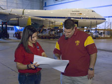 NASA cooperative education student intern Krystal Gunter and electrical engineer Matt Reaves discuss wiring diagrams for NASA's Stratospheric Observatory for Infrared Astronomy, or SOFIA, 747SP aircraft.