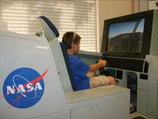 A young visitor flies a space shuttle landing simulator in the Aerospace Exploration Gallery at the AERO Institute in Palmdale during Thursday Night on the Square.