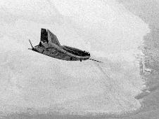 HL-10 in flight over lakebed