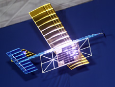 A model plane is powered by a laser beam.