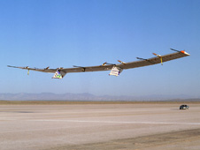 The Pathfinder-Plus solar-electric flying wing lifts off Rogers Dry Lake.