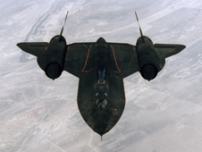 The SR-71 is photographed in flight above the high desert.