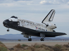 Space Shuttle Discovery rolls out on Runway 22L after landing at Edwards Air Force Base to conclude mission STS-128 to the International Space Station.