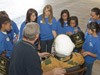 A group of middle school students gather around Dryden life support technician Jim Sokolik as he explains the workings of a high-altitude pilot's pressure suit.
