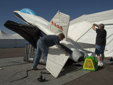 NASA Dryden public affairs director Kevin Rohrer (left) and Dryden life support technician Jim Sokolik set up NASA's half-scale, inflatable F/A-18 model