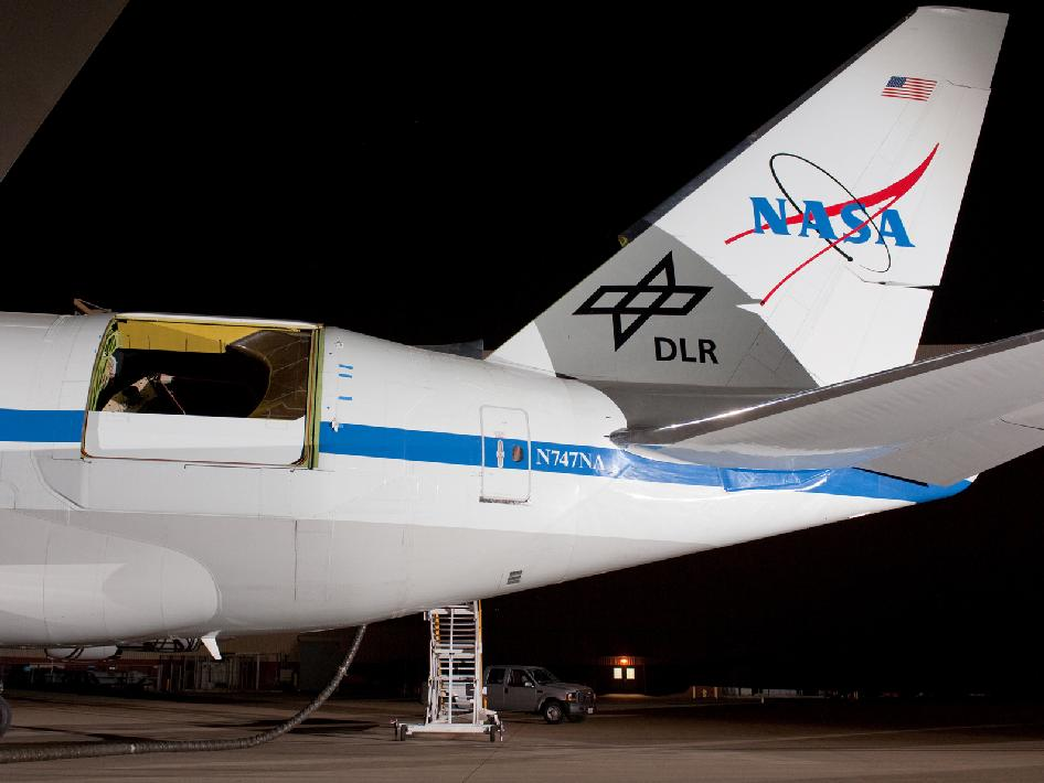 The rear fuselage of the Stratospheric Observatory for Infrared Astronomy's 747SP is illuminated during telescope testing operations