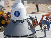 Using mock-up components, technicians at the U.S. Army's White Sands Missile Range in New Mexico recently practiced the stacking process that will be involved in mating the Orion Pad Abort-1 flight test launch abort system and crew module.