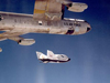 The X-38 research vehicle drops away from NASA's B-52 mothership immediately after being released from the B-52's wing pylon during a 1999 test flight.