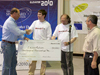 Andy Petro of NASA's Centennial Challenges program congratulates Tom Nugent and Jordan Kare of the LaserMotive team that won the Space Elevator Power-Beaming Challenge Games at NASA Dryden Nov. 6