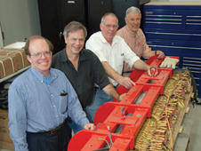 Leo Holland, Rick Hutsell, Kurt Kloesel and Don Ketchen look at the linear induction motor that creates magnetic waves.
