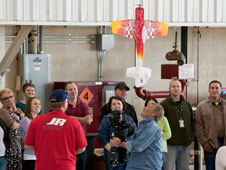 Model aircraft flier Mark Leseberg performs a flight demonstration for Dryden employees