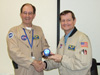 Frank Batteas, right, presents Bill Brockett with an award for exceptional leadership in the Airborne Sciences program.
