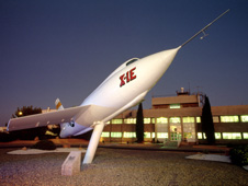 X-1E on stand in front of Dryden's main building.