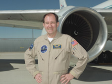 NASA research pilot Bill Brockett in front of NASA's modified DC-8 airborne science laboratory, one of several NASA environmental and space science aircraft that he flies
