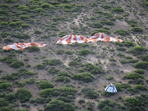 Pad Abort-1 flight test crew module and its main parachutes.