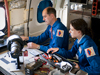 Project scientist Peter Jenniskens of the SETI Institute and NASA's Ames Research Center and Christina Giannopapa of the Netherlands' Eindhoven University prepare lenses for one of the specialized cameras on the DC-8.