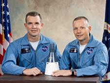 Astronauts David R. Scott (left), Pilot; and, Neil A. Armstrong (right), Command Pilot, pose with model of the Gemini Spacecraft after being selected at the crew for the Gemini VIII mission.