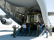 The Orion PA-1 flight test crew module is unloaded from a Mississippi Air National Guard C-17 at Dryden after a ferry flight from Holloman Air Force Base, near White Sands Missile Range in New Mexico.