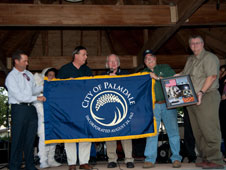 Palmdale officials receiving flag flown on STS-132