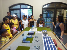 Informal education intern Mia Niloexplains the Green Tech Airfield exhibit at the AERO Institute in Palmdale, Calif