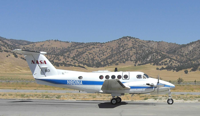 NASA 801, a Beechcraft B-200 King Air flown by NASA's Dryden Flight Research Center for a variety of research experiments, rolls along the taxiway at the municipal airport in Tehachapi, Calif.,
